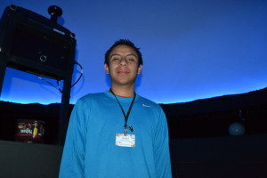 CELESTIAL HORIZON. Godinez stands under the domed sky of Gladwin Planetarium